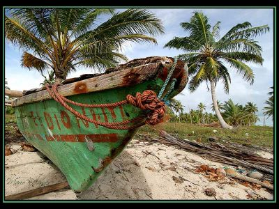 Green boat on the beach