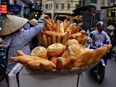 Man selling bread in a street of Vietnam