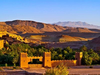 Typical architecture of Morocco with desert on the background