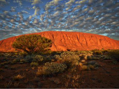 Ayers Rock, the impressive mountain that changes color depending on the sunlight, Australia.
